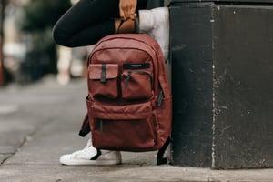Brown backpack on street corner
