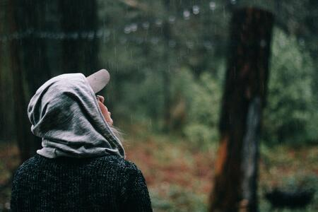 girl with hoodie stuck in the rain