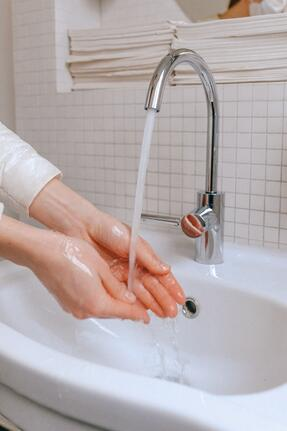 Washing hands by sink
